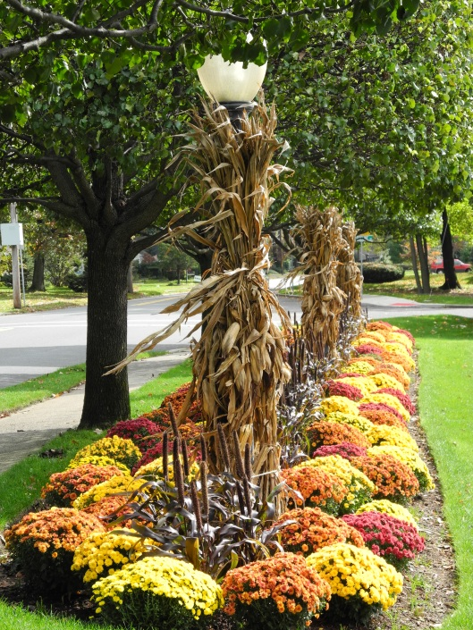 lamposts and garden decorated for autumn