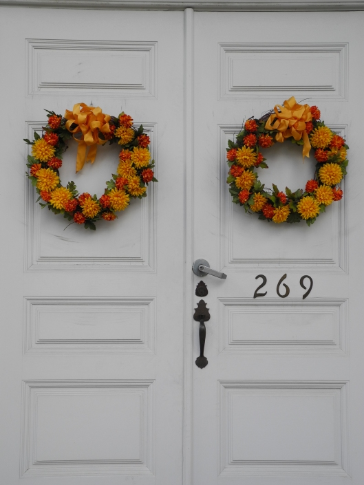 autumn weaths on white double doors