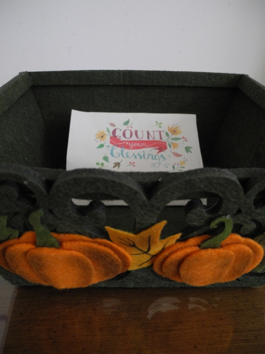Blessings lists in a green felt  basket with pumpkins