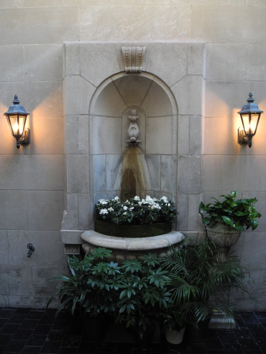 Stone fountain at an indoor courtyard.