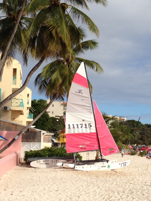 Pink sailboat in the sand