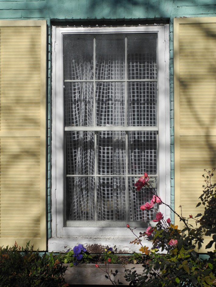 Pastel Building with white lace curtain in Georgetwon